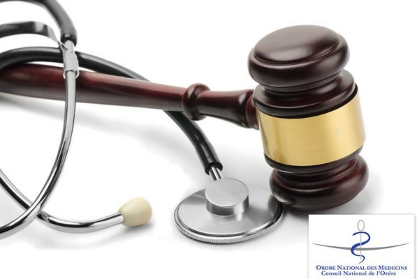 24020312 - close up of stethoscope and gavel on white background